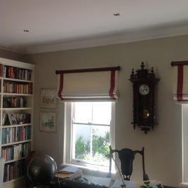 Roman Blind With Border Behind Rod