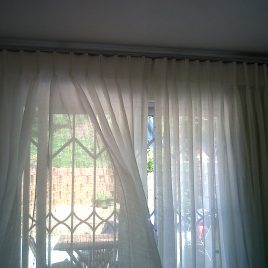 Sheer Curtains On Stainless Steel Pole